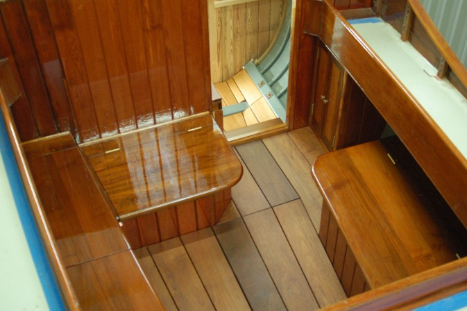 Teak cockpit during varnishing.